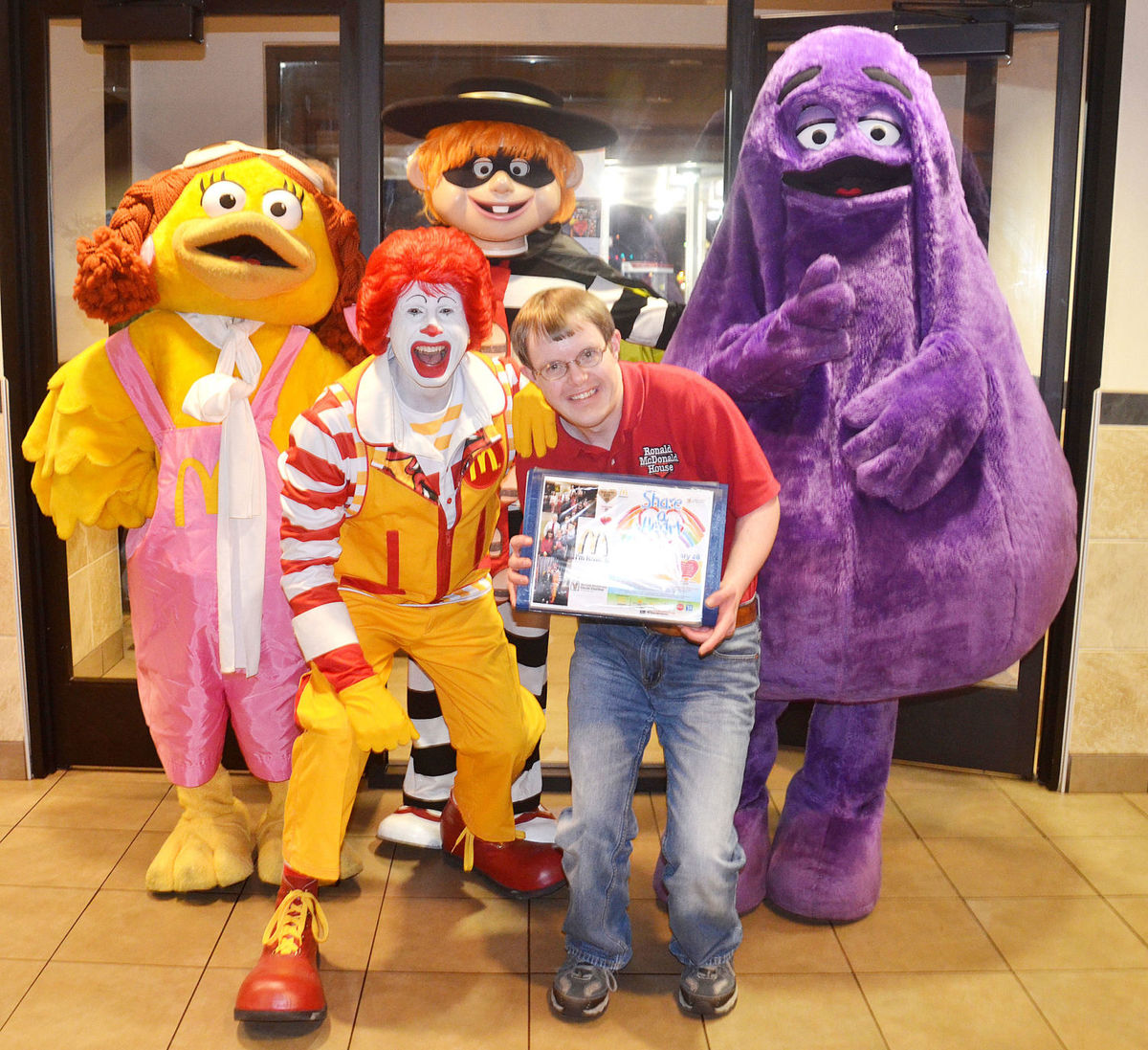 TJ Slocum posing with some of the McDonald's characters on a past McTJ Night.