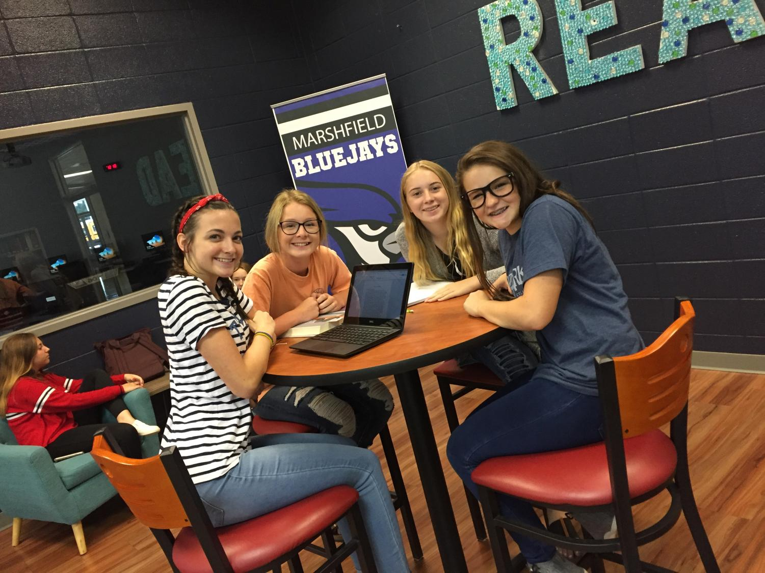 Freshman Bria Marlin, Haley Barker, Kenzie Sharp, and Lilliegh Rahmoeller are in the school library working on their homework.
