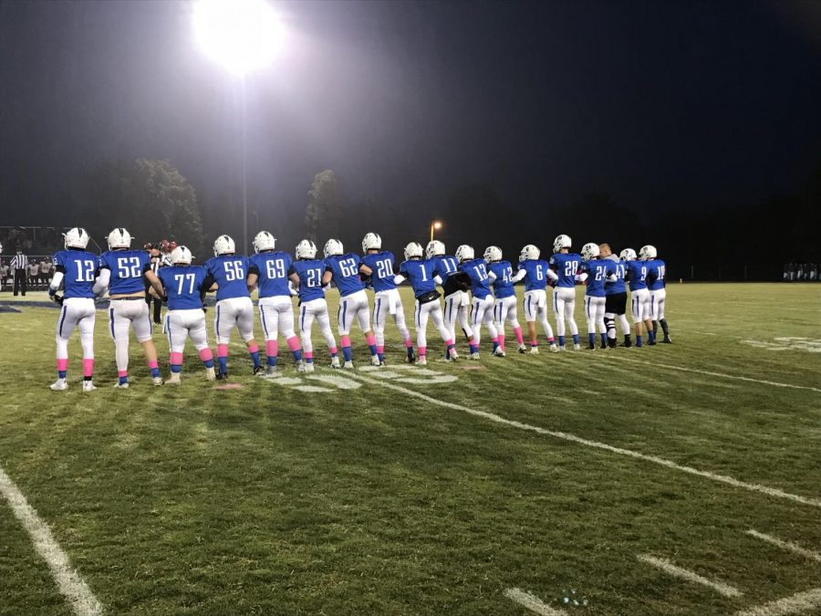 Seniors lining up before the coin toss.