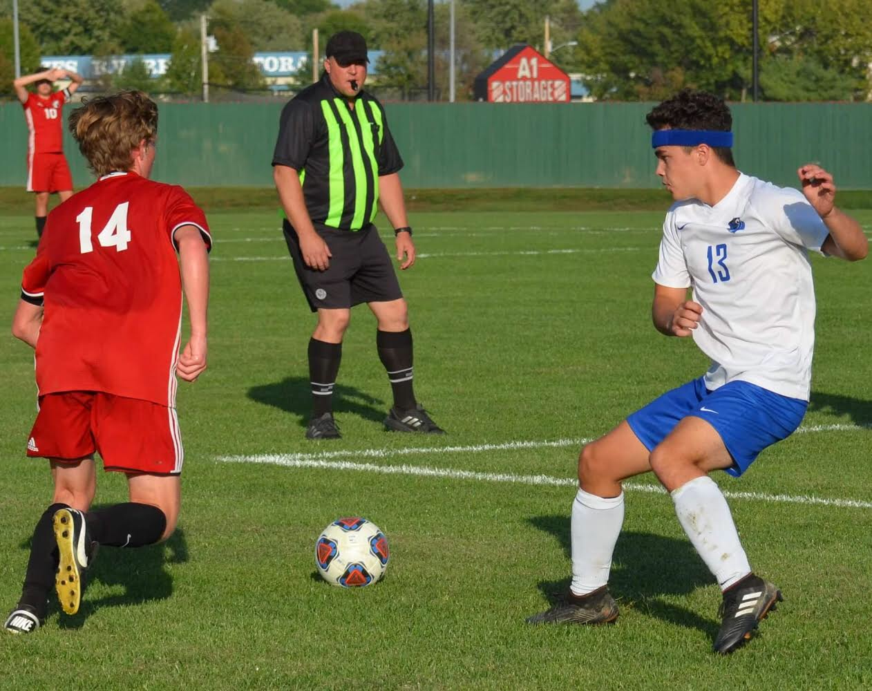 Cole Hartman, defending for the Jays against a New Covenant player