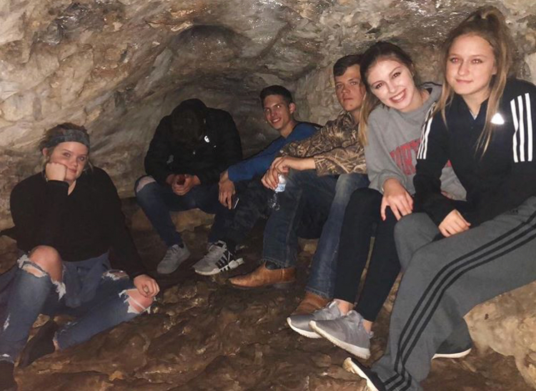 A group students, view the cave  during the Ecology field trip.