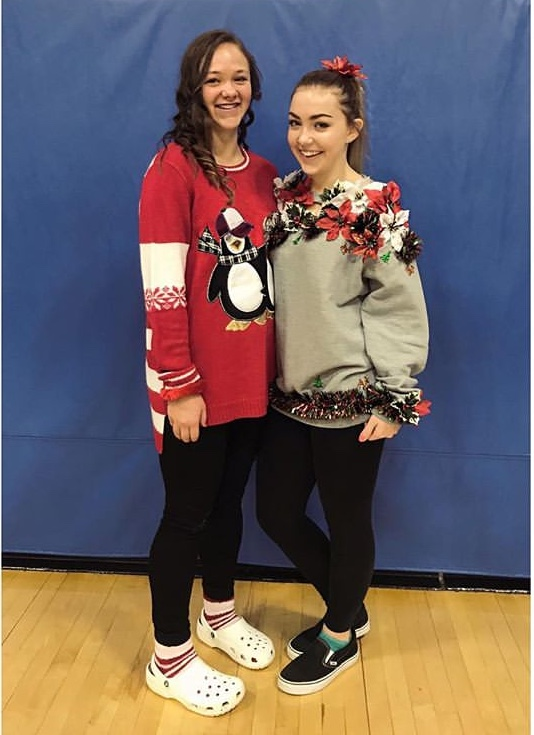 On+the+left+is+Freshman+Kiana+Massie+and+and+on+the+right+is+Freshman+Sam+Bargwell.+They+are+both+dressed+in+their+ugly+sweater.+
