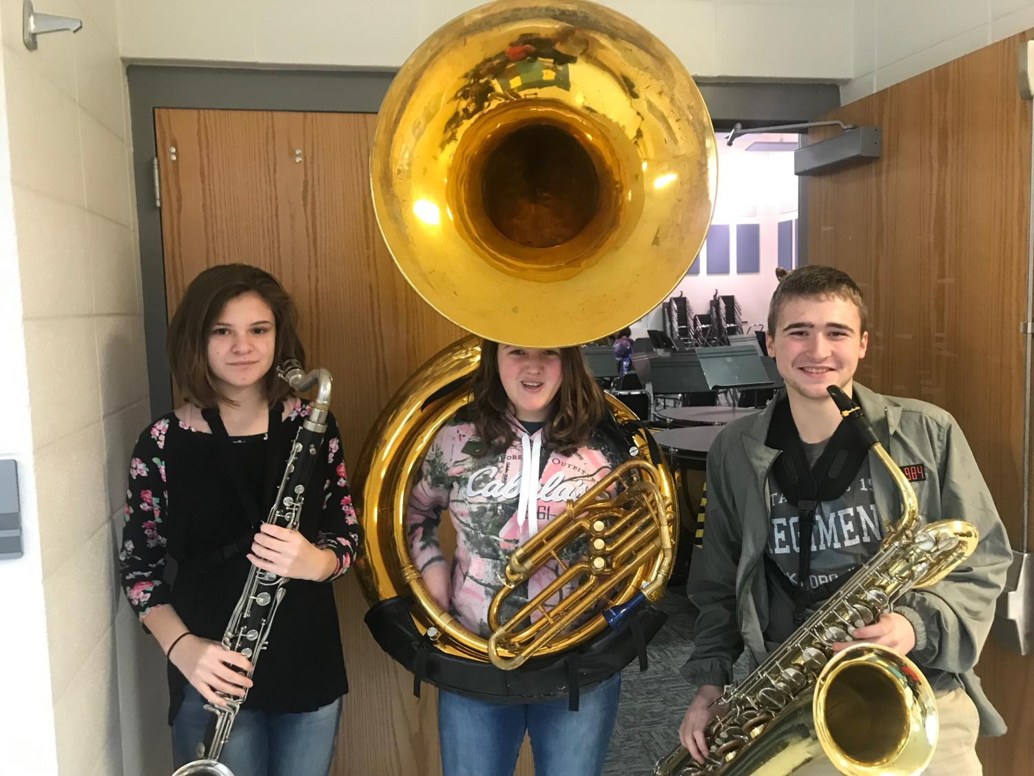 Alex, and some friends pose for a picture with their instruments.