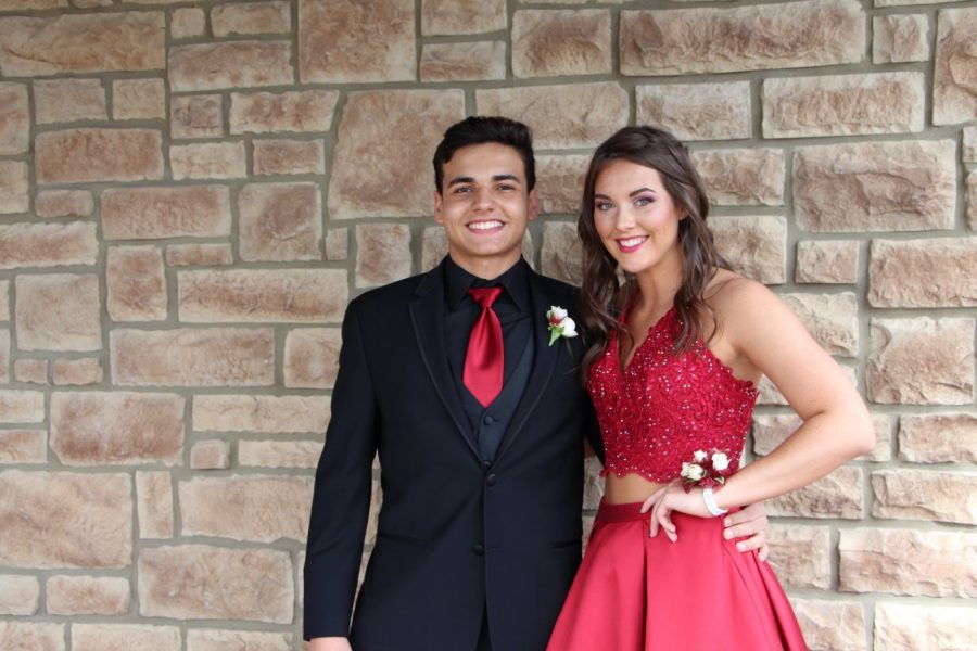 Student of the week Ricardo Aguimo(left) , stands with his prom date Alexis Moon (right), senior.